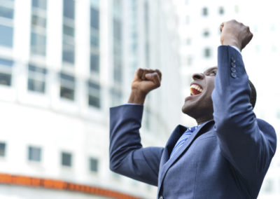 Man in a business suit shouting from excitement
